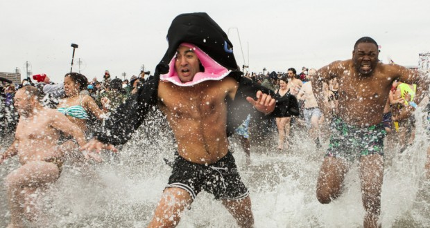 Polar Bear Club Swimmers Take Icy Plunge On New Years Day